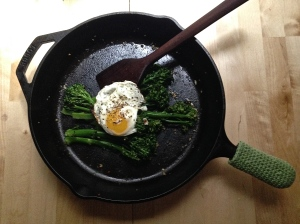 Cast iron pan with broccolini and egg